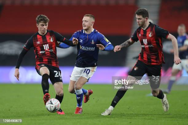 Joshua King of AFC Bournemouth is challenged by Davis Keillor-Dunn of Oldham Athletic who is under pressure from Jack Simpson of AFC Bournemouth...