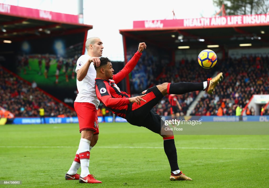 Joshua King of AFC Bournemouth is challenged by Oriol Romeu of Southampton during the Premier League match between AFC Bournemouth and Southampton at Vitality Stadium on December 3, 2017 in Bournemouth, England.