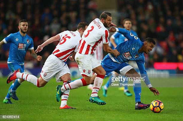 Joshua King of AFC Bournemouth is fouled by Erik Pieters of Stoke City during the Premier League match between Stoke City and AFC Bournemouth at...