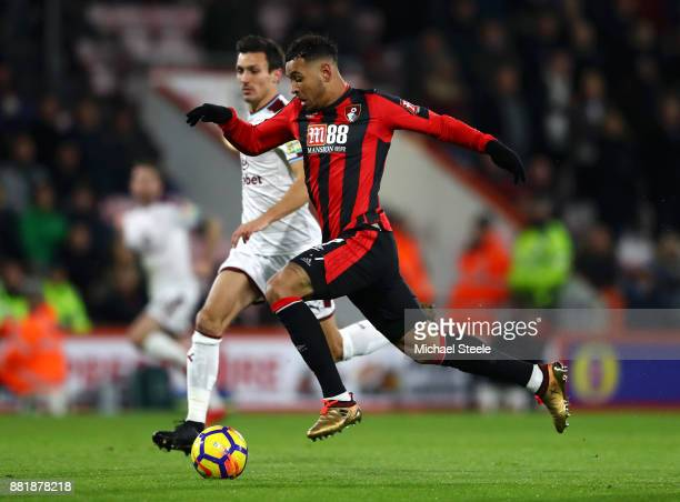 Joshua King of AFC Bournemouth is put under pressure from Jack Cork of Burnley during the Premier League match between AFC Bournemouth and Burnley at...