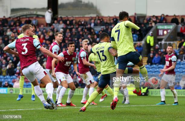 Joshua King of AFC Bournemouth scores a goal which is later ruled out by VAR for handball during the Premier League match between Burnley FC and AFC...