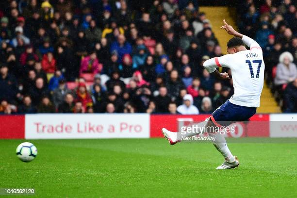 Joshua King of AFC Bournemouth scores a penalty for his team's second goal during the Premier League match between Watford FC and AFC Bournemouth at...
