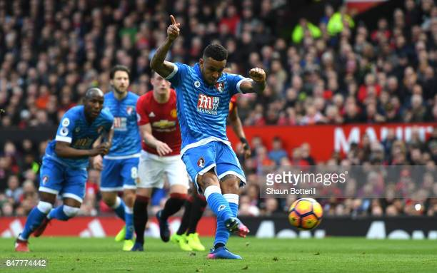 Joshua King of AFC Bournemouth scores his sides first goal from the penalty spot during the Premier League match between Manchester United and AFC...