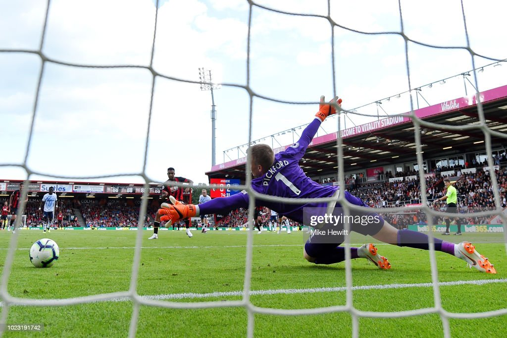 Joshua King of AFC Bournemouth scores his team's first goal from a penalty past Jordan Pickford of Everton during the Premier League match between AFC Bournemouth and Everton FC at Vitality Stadium on August 25, 2018 in Bournemouth, United Kingdom.