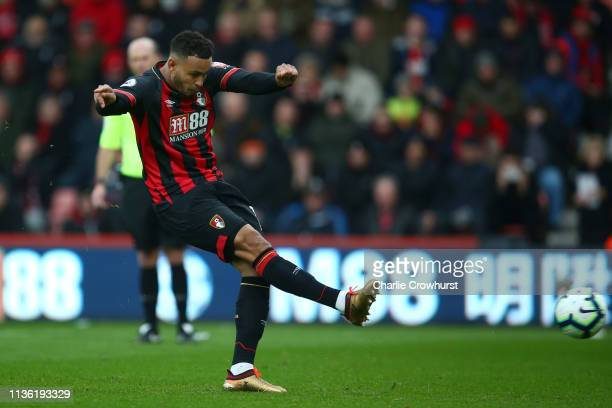 Joshua King of AFC Bournemouth scores his team's first goal from the penalty spot during the Premier League match between AFC Bournemouth and...