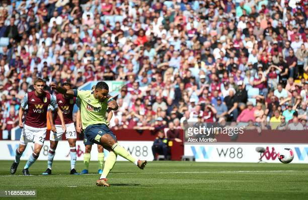 Joshua King of AFC Bournemouth scores his team's first goal from the penalty spot during the Premier League match between Aston Villa and AFC...
