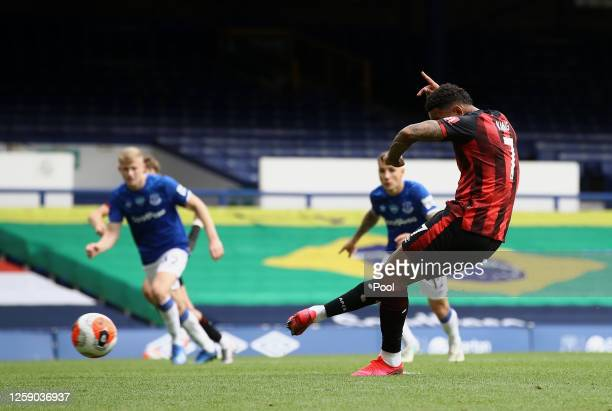 Joshua King of AFC Bournemouth scores his team's first goal from the penalty spot during the Premier League match between Everton FC and AFC...