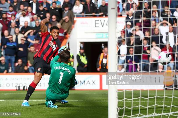 Joshua King of AFC Bournemouth scores his team's first goal past Lukasz Fabianski of West Ham United during the Premier League match between AFC...