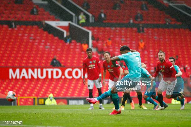 Joshua King of AFC Bournemouth scores his team's second goal from a penalty during the Premier League match between Manchester United and AFC...