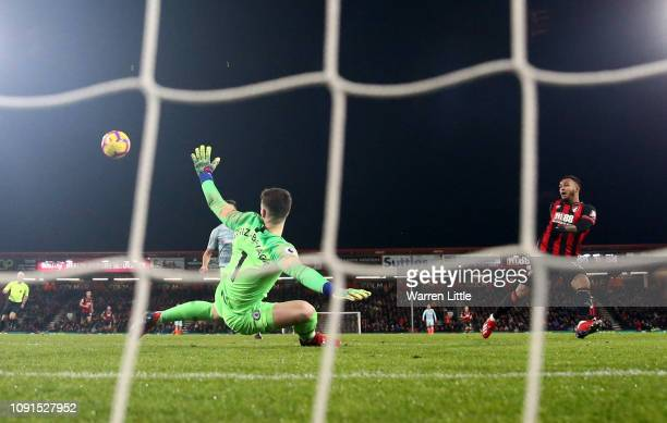Joshua King of AFC Bournemouth scores his team's third goal past Kepa Arrizabalaga of Chelsea during the Premier League match between AFC Bournemouth...