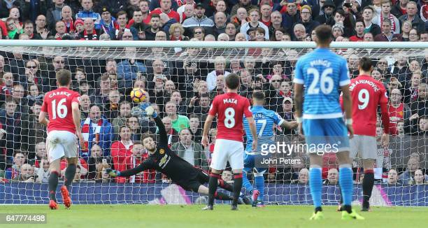 Joshua King of AFC Bournemouth scores their first goal during the Premier League match between Manchester United and AFC Bournemouth at Old Trafford...