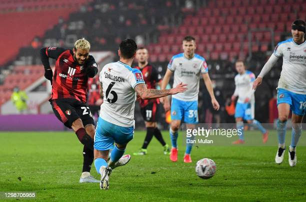Joshua King of AFC Bournemouth scores their team's second goal while under pressure from Tom Dallison of Crawley Town during The Emirates FA Cup...