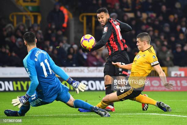 Joshua King of AFC Bournemouth shoots while under pressure from Conor Coady of Wolverhampton Wanderers during the Premier League match between...