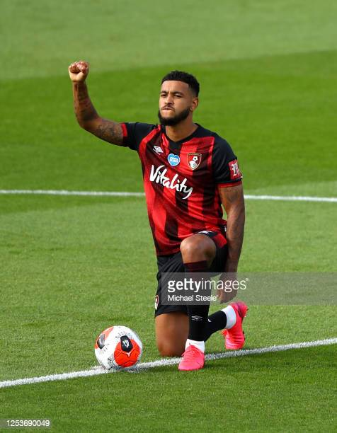 Joshua King of AFC Bournemouth takes a knee in support of the Black Lives Matter movement prior to the Premier League match between AFC Bournemouth...