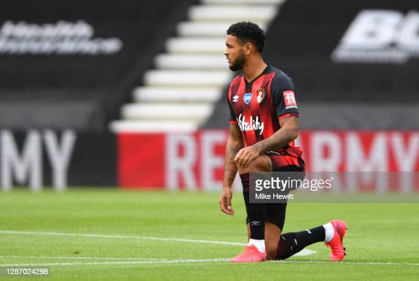 Joshua King of AFC Bournemouth takes a knee in support of the Black Lives Matter movement prior to during the Premier League match between AFC...