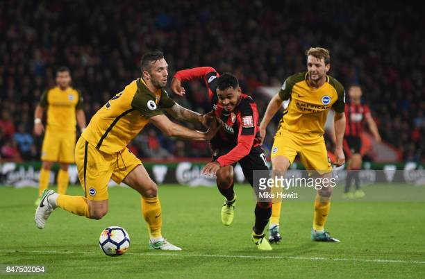 Joshua King of AFC Bournemouth takes on Shane Duffy and Dale Stephens of Brighton and Hove Albion during the Premier League match between AFC...