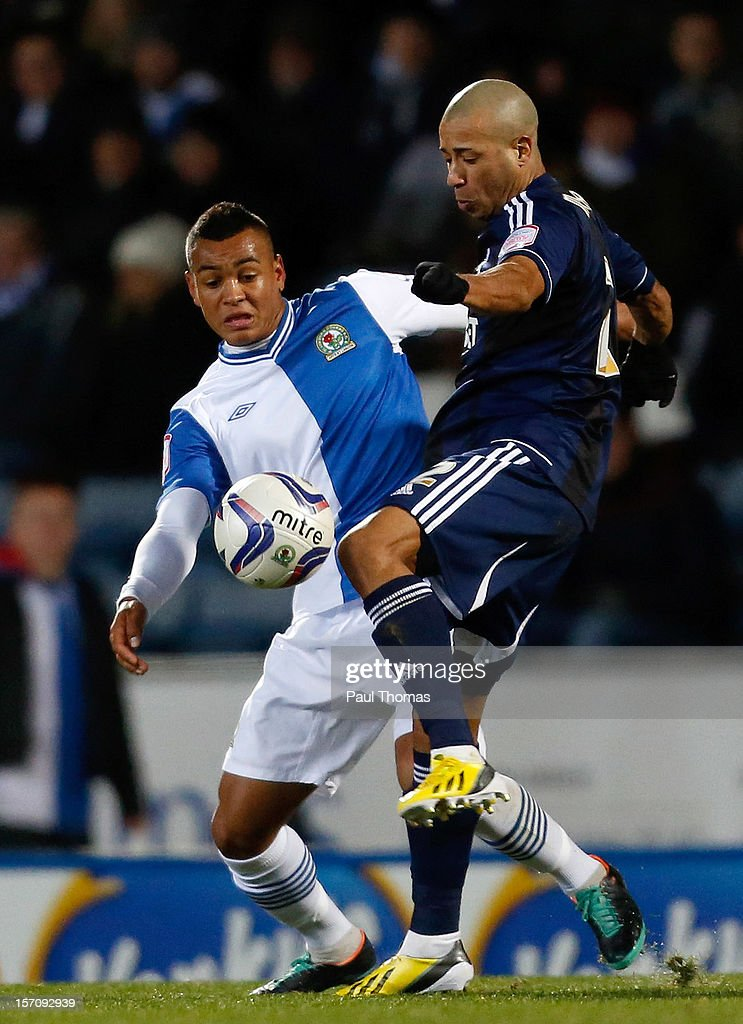 Joshua King (L) of Blackburn in action with Tyrone Mears of Bolton during the npower Championship match between Blackburn Rovers and Bolton Wanderers at Ewood Park on November 28, 2012 in Blackburn, England.
