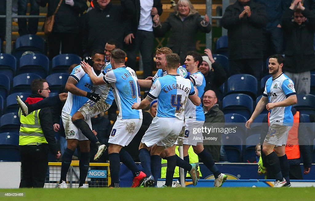 Joshua King of Blackburn is mobbed by team mates after scoring the fourth goal and his hat trick during the FA Cup Fifth Round match between Blackburn Rovers and Stoke City at Ewood park on February 14, 2015 in Blackburn, England.