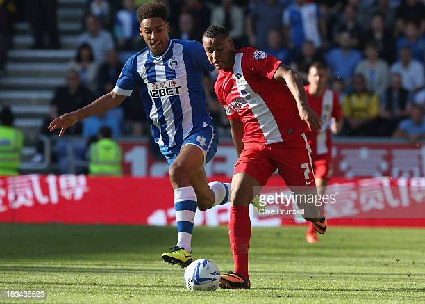 Joshua King of Blackburn Rovers attempts to move away from Ryan Shotton of Wigan Athletic during the Sky Bet Championship match between Wigan...