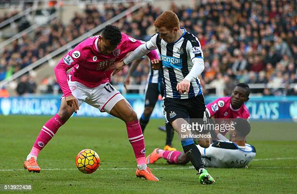 Joshua King of Bourenmouth vies with Jack Colback of Newcastle United during the Barclays Premier League match between Newcastle United and AFC...