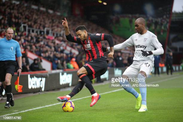 Joshua King of Bournemouth and Angelo Ogbonna of West Ham United compete for the ball during the Premier League match between AFC Bournemouth and...