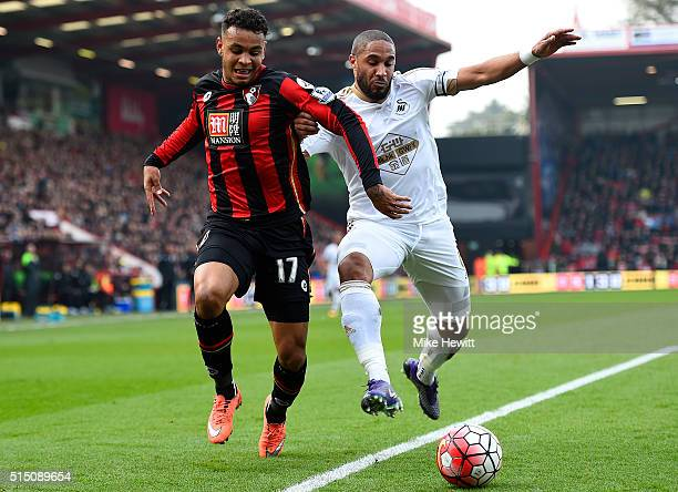 Joshua King of Bournemouth and Ashley Williams of Swansea City compete for the ball during the Barclays Premier League match between AFC Bournemouth...