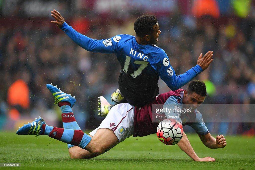 Joshua King of Bournemouth and Ciaran Clark of Aston Villa compete for the ball during the Barclays Premier League match between Aston Villa and A.F.C. Bournemouth at Villa Park on April 9, 2016 in Birmingham, England.