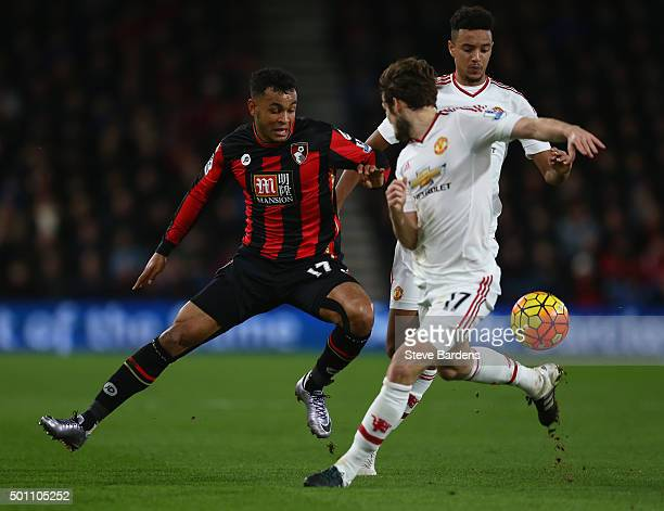 Joshua King of Bournemouth and Daley Blind of Manchester United compete for the ball during the Barclays Premier League match between AFC Bournemouth...