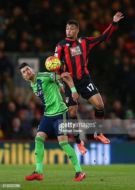 Joshua King of Bournemouth and Jose Fonte of Southampton compete for the ball during the Barclays Premier League match between AFC Bournemouth and...