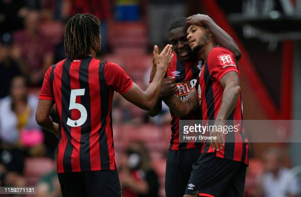 Joshua King of Bournemouth celebrates with team mates after scoring their third goal during the Pre-Season Friendly match between AFC Bournemouth and...