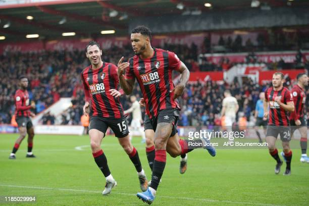 Joshua King of Bournemouth celebrates with teammates after he scores a goal to make it 10 during the Premier League match between AFC Bournemouth and...