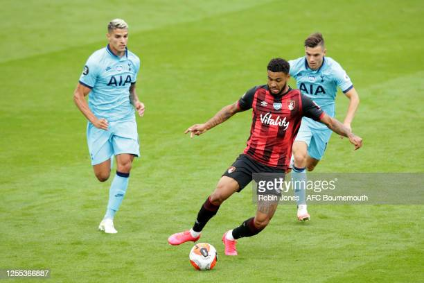 Joshua King of Bournemouth is closed down by Erik Lamela and Giovani Lo Celso of Tottenham Hotspur during the Premier League match between AFC...