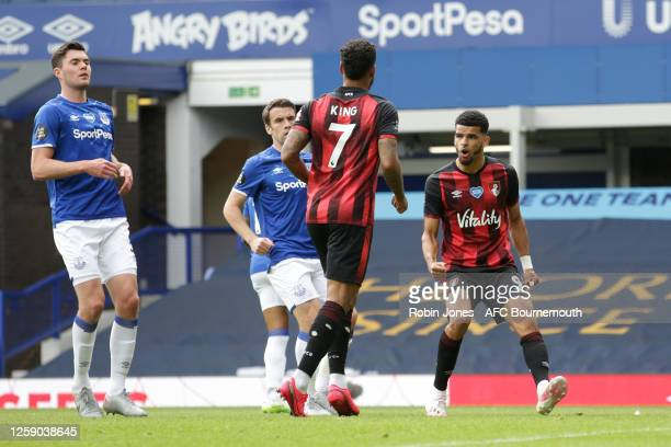 Joshua King of Bournemouth is congratulated after he scores a goal to make it 10 from the spot by teammate Dominic Solanke during the Premier League...