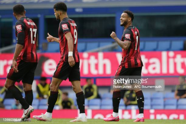 Joshua King of Bournemouth is congratulated after he scores a goal to make it 10 from the spot by teammates Callum Wilson and Dominic Solanke during...