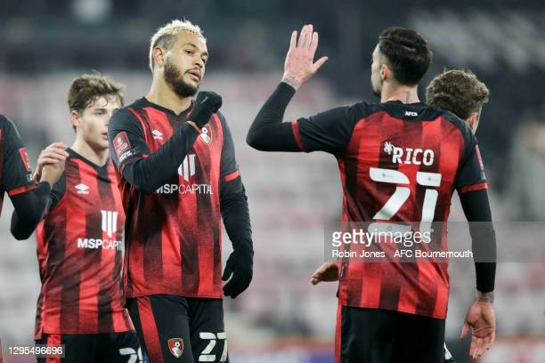 Joshua King of Bournemouth is congratulated by team-mate Diego Rico after he scores a goal to make it 4-1 during FA Cup 3rd Round match between...