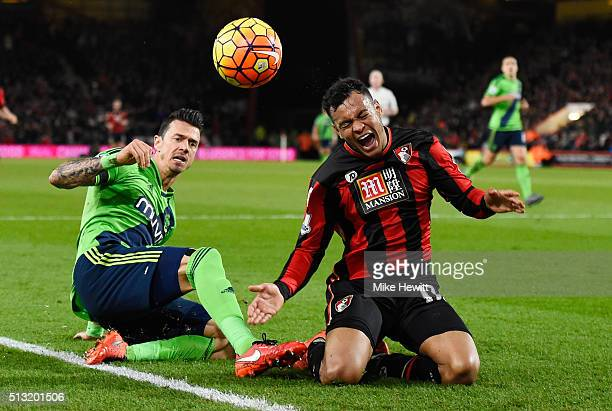 Joshua King of Bournemouth is tackled by Jose Fonte of Southampton during the Barclays Premier League match between AFC Bournemouth and Southampton...