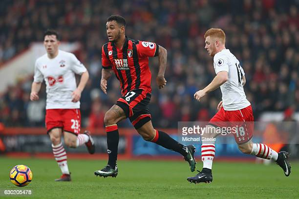Joshua King of Bournemouth is tracked by Harrison Reed of Southampton during the Premier League match between AFC Bournemouth and Southampton at the...