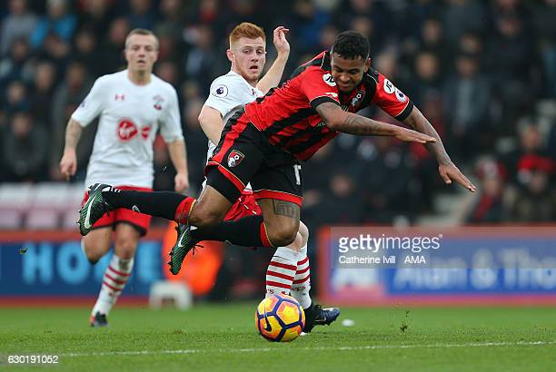 Joshua King of Bournemouth is tripped by Harrison Reed of Southampton during the Premier League match between AFC Bournemouth and Southampton at...