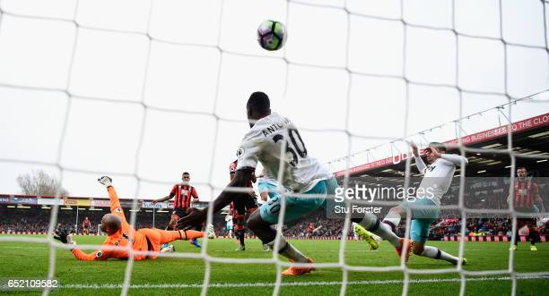 Joshua King of Bournemouth scores the winning goal past goalkeeper Darren Rudolph and Michail Antonio during the Premier League match between AFC...