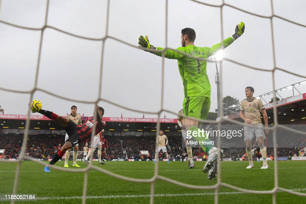 Joshua King of Bournemouth volleys the ball past David De Gea of Manchester United to score the winning goal during the Premier League match between...