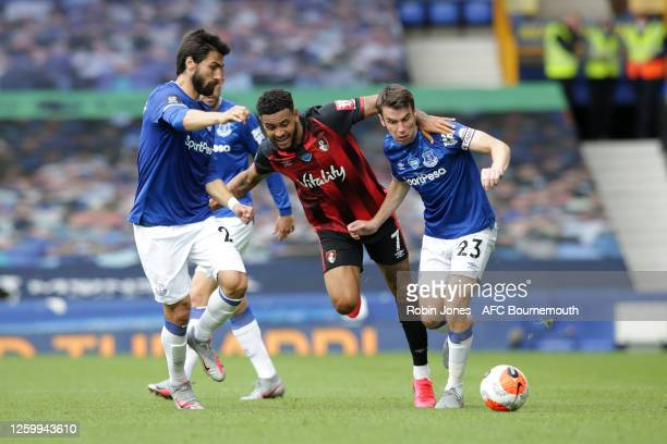 Joshua King of Bournemouth with Andre Gomes and Seamus Coleman of Everton during the Premier League match between Everton FC and AFC Bournemouth at...
