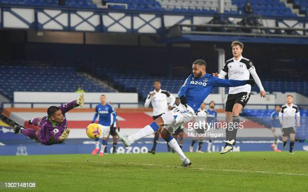 Joshua King of Everton scores their side's first goal past Alphonse Areola of Fulham, but was later ruled due to offside during the Premier League...