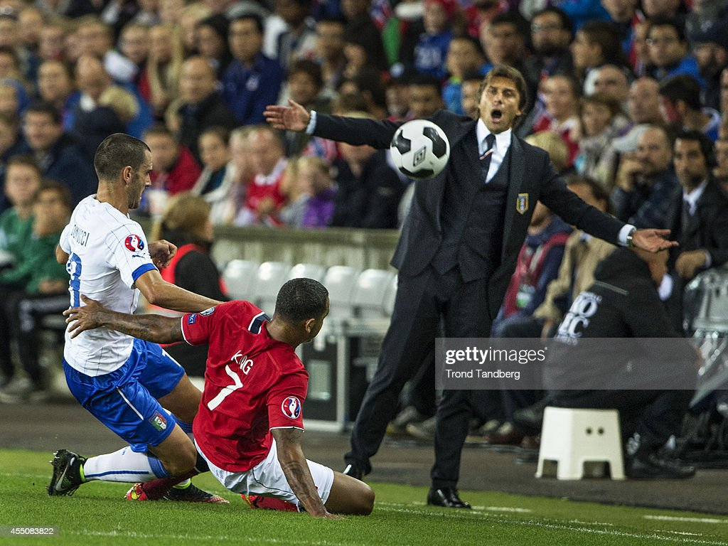 Joshua King of Norway and Leonardo Bonucci and head coach Antonio Conte of Italy during the UEFA EURO 2016 qualifier match between Norway and Italy at Ullevaal Stadion on September 9, 2014 in Oslo, Norway.