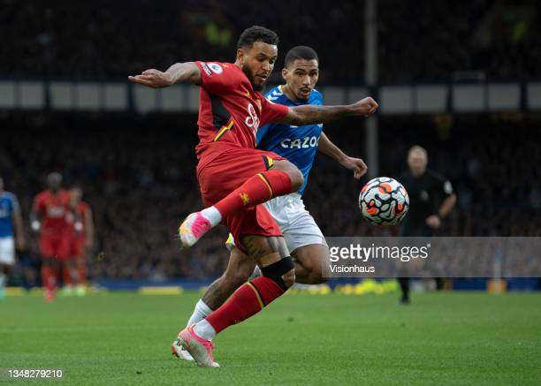 Joshua King of Watford and Allan of Everton in action during the Premier League match between Everton and Watford at Goodison Park on October 23,...