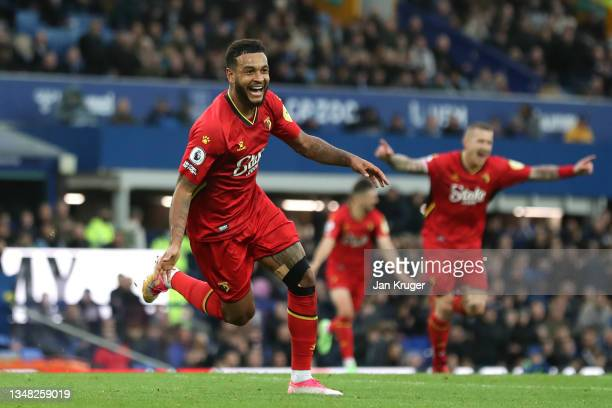 Joshua King of Watford celebrates scoring during the Premier League match between Everton and Watford at Goodison Park on October 23, 2021 in...