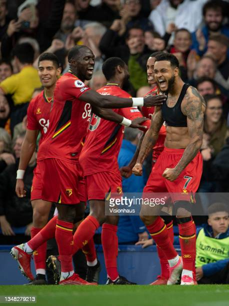 Joshua King of Watford celebrates scoring their third goal goal and his second during the Premier League match between Everton and Watford at...