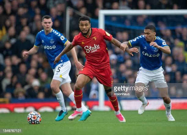 Joshua King of Watford in action with Allan and Michael Keane of Everton during the Premier League match between Everton and Watford at Goodison Park...