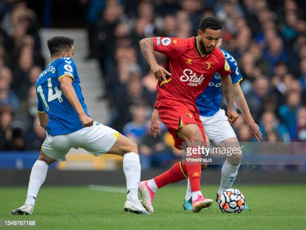 Joshua King of Watford in action with Michael Keane and Andros Townsend of Everton during the Premier League match between Everton and Watford at...