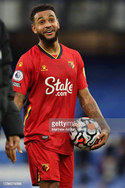 Joshua King of Watford walks off with the match ball after scoring a hat-trick in the 2-5 victory during the Premier League match between Everton and...