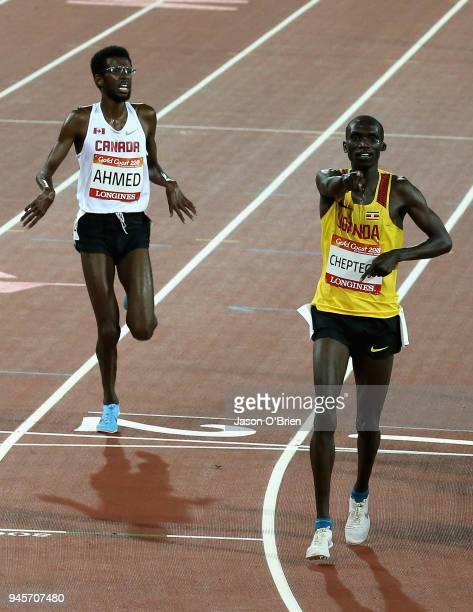 Joshua Kiprui Cheptegei of Uganda celebrates winning gold as he crosses the line ahead of Mohammed Ahmed of Canada in the Men's 10000 metres final...